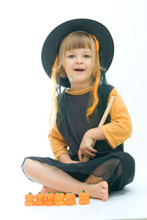 little girl dressed up as a witch photo