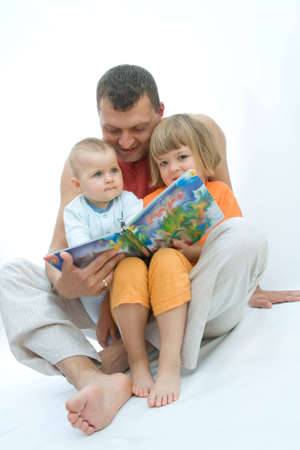 young father reading fairy tale to children Stock Photo - 3574119