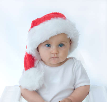 little, cute baby boy wearing Christmas hat, on white Stock Photo - 3662937