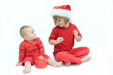 Christmas kids in Santa hat on white background photo