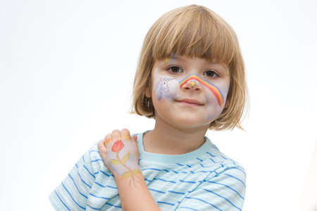 lovely, happy little  girl with painted face photo