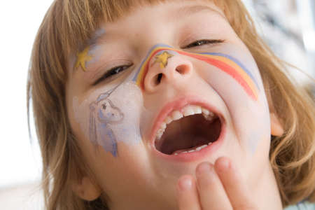 lovely, happy little  girl with painted face