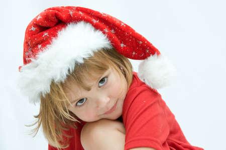 Christmas kid in Santa hat on white background photo