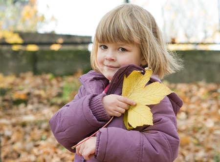 little, cute girl on an autumn walk Stock Photo