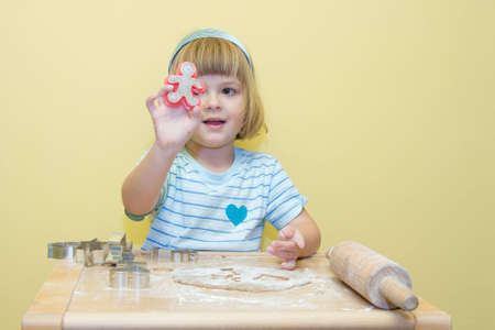 hairband: cute, little girl baking Christmas gingerbread
