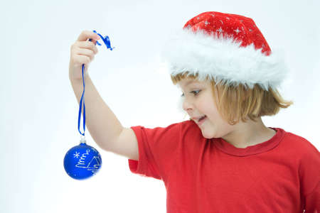 little Santa girl and Christmas baubles, on white Stock Photo - 3813354