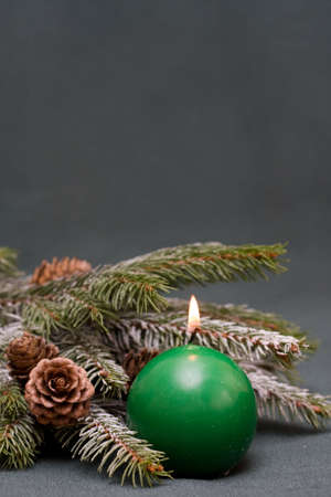 Christmas composition of conifer, cones and candle photo