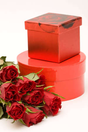 bunch of red roses and gift box, on white photo