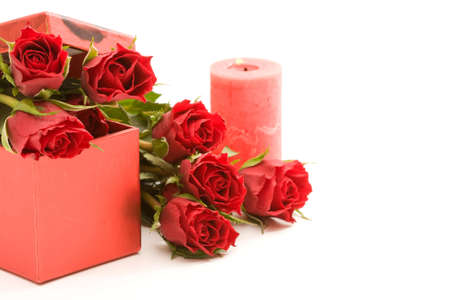 red roses in gift box, on white background photo