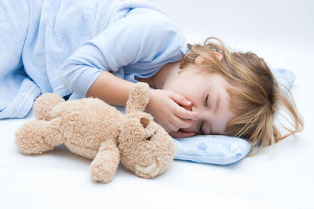 child with teddy bear, sleeping and crying Stock Photo