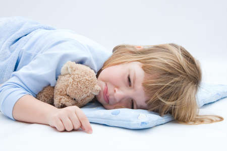 child crying: child with teddy bear, sleeping and crying Stock Photo