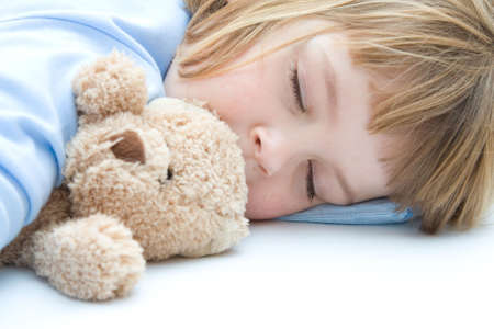 sleeping kid: little girl sleeping and hugging her teddy bear