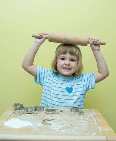 cute, little girl baking Christmas gingerbread Stock Photo - 3828221