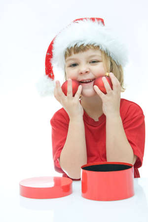 little Santa girl and Christmas baubles, on white photo