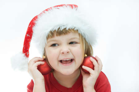little Santa girl and Christmas baubles, on white Stock Photo