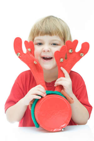 little, cute girl with Christmas gift and reindeer horns photo