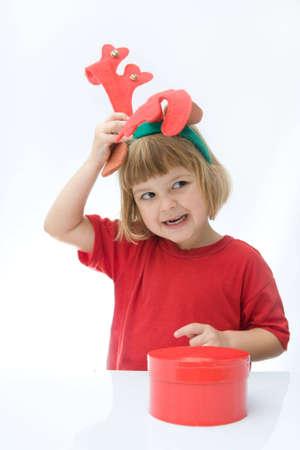 little girl wearing reindeer horn headband, on white photo