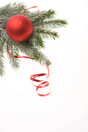 red Christmas bauble and ribbon on white background Stock Photo - 3828182