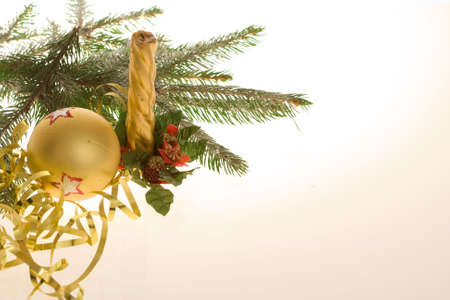 golden bauble, ribbon and spruce twigs on light background Stock Photo - 3850253