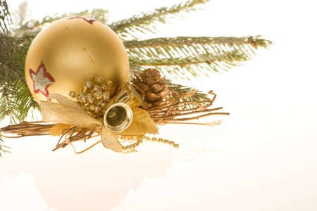 Christmas bauble and spruce on light background photo