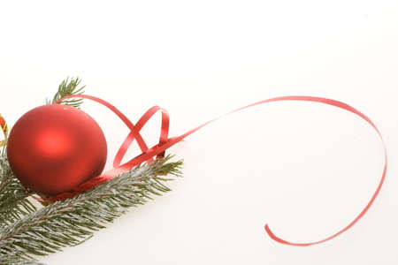 red bauble, ribbon and spruce twigs on light background Stock Photo - 3850248