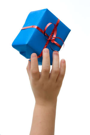 kid hand holding Christmas gift on white background Stock Photo - 3850241