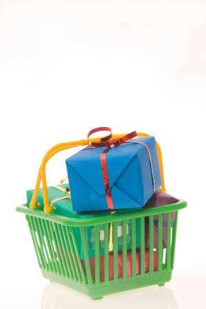 green shopping basket full of Christmas gifts Stock Photo - 3850245