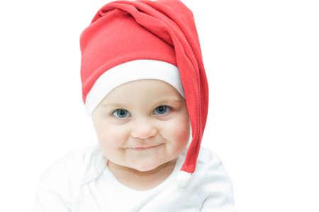 little, cute baby boy in Santa hat, on white photo