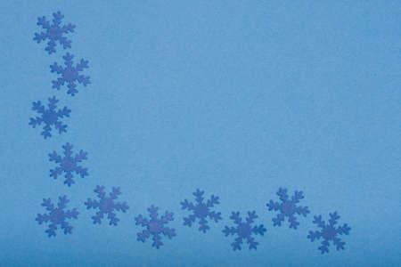 winter background - composition of snowfaleks on blue photo
