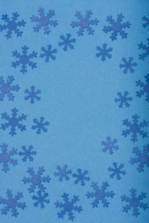 winter background - composition of snowfaleks on blue photo