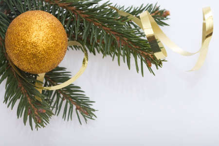 golden Christmas balls, spruce and spiral ribbon Stock Photo - 3939657