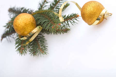 golden Christmas balls, spruce and spiral ribbon Stock Photo - 3939650