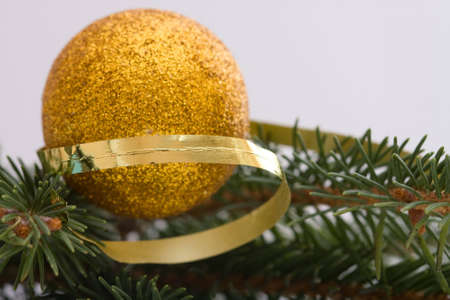 golden Christmas balls, spruce and spiral ribbon Stock Photo - 3939658