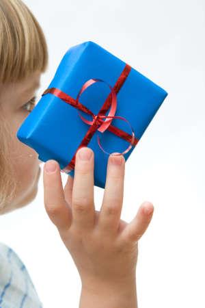 kid hand holding Christmas gift on white background photo