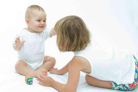 cute baby boy having fun with his sister Stock Photo - 4004984