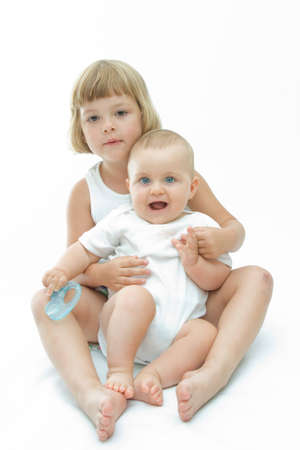 cute baby boy having fun with his sister Stock Photo - 4004982