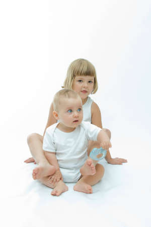 cute baby boy having fun with his sister Stock Photo - 4004976