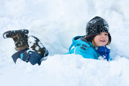 little girl having fun in the snow Stock Photo