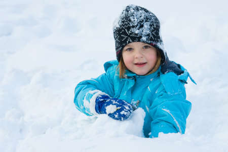little girl having fun in the snow Stock Photo