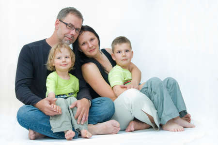 happy family of four, parent with two sons photo