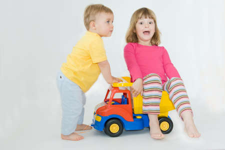 happy siblings playing together, on white