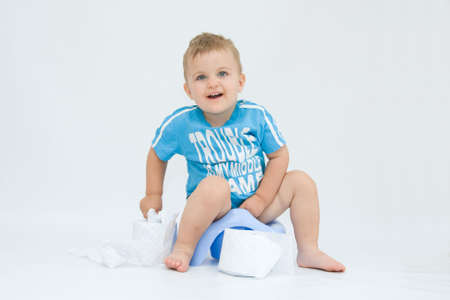 potty: cute, little boy while potty training, on white