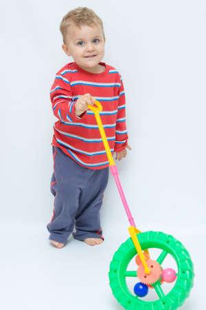 cute, little toddler pushing a wheel