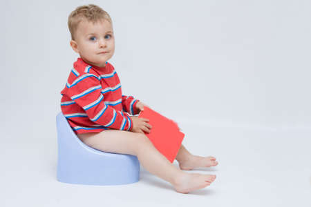 innocense: cute, little boy while potty training Stock Photo