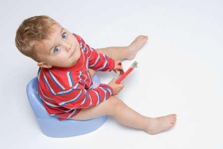 cute, little boy while potty training Stock Photo
