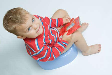 cute, little boy while potty training photo