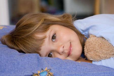 sleeping kid: cute little girl sleeping on a blue pillow Stock Photo