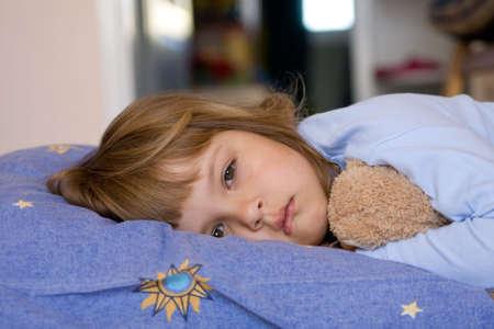 cute little girl sleeping on a blue pillow Stock Photo