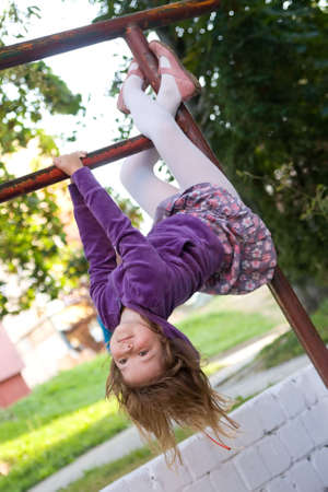 cute, little pretty girl having fun outdoors photo