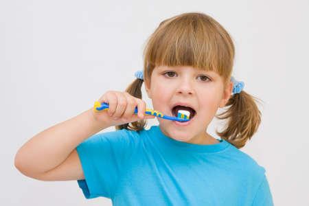 ponytails: cute, little girl brushing her teeth